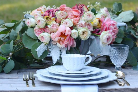 Flowers and fresh leaves add natural beauty to the table