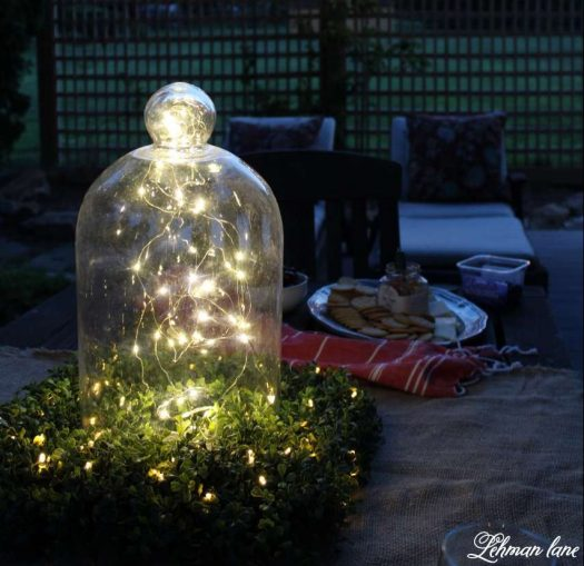 String lights in a glass cloche