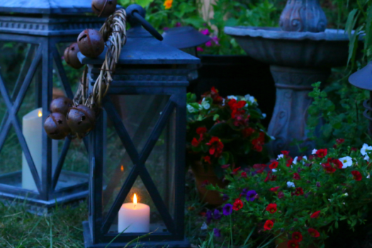 Fairy lights wrapped around a metal globe