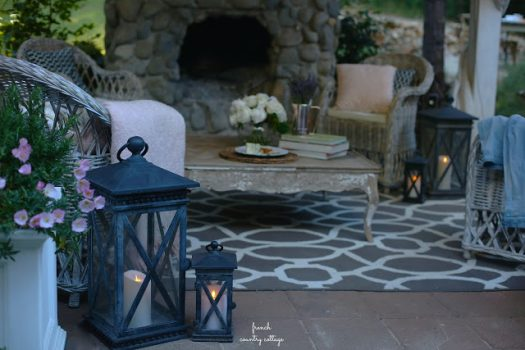 Flameless candles and metal lanterns adding a warm glow