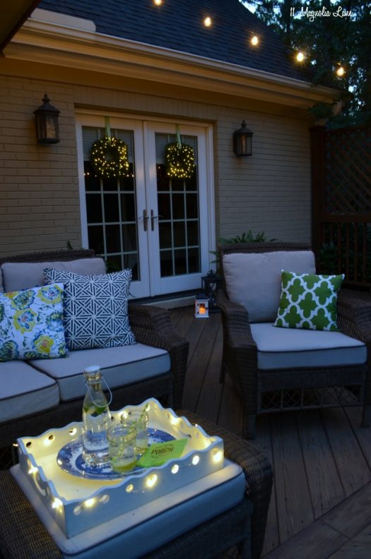Outdoors with beautiful string lights and boxwood wreaths