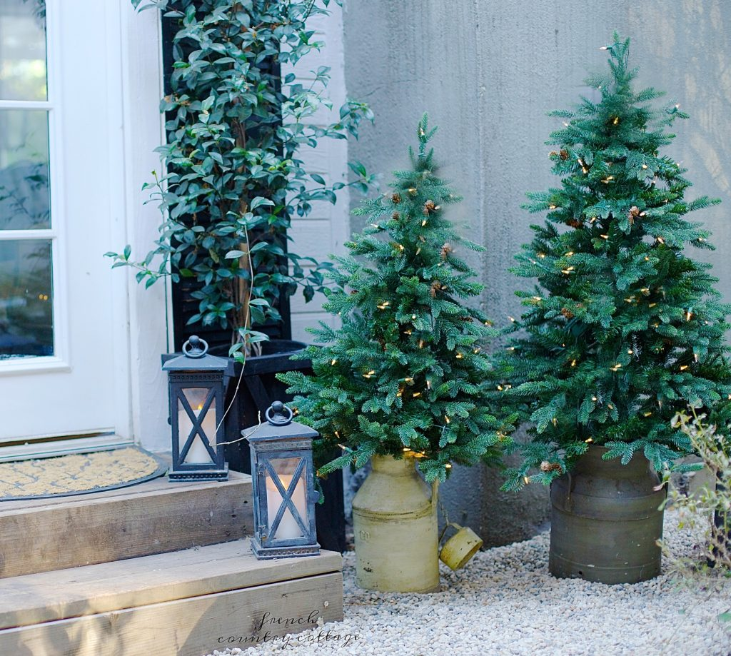 Pre-lit potted trees in vintage milk containers