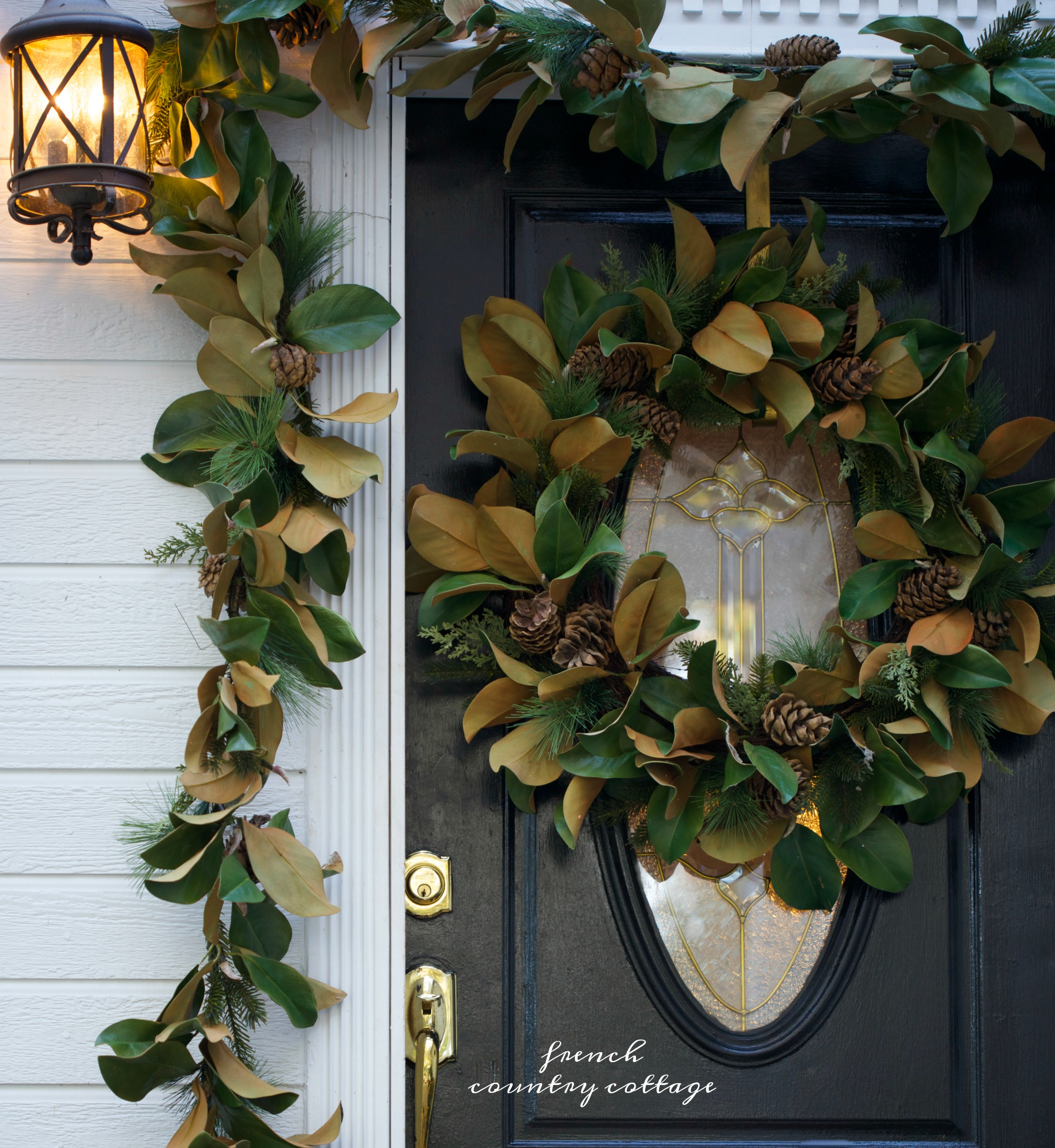 Beautiful front porch with magnolia wreath and garland
