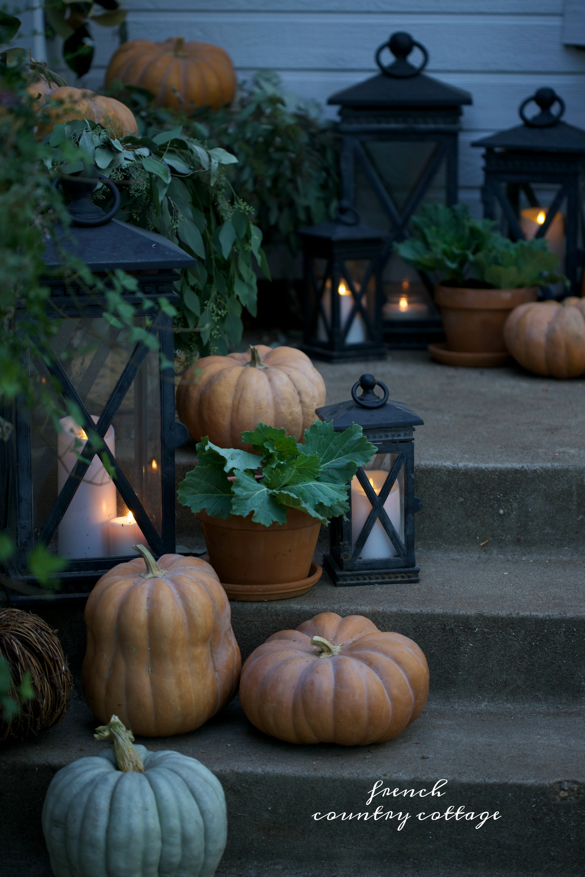 Pumpkin and foliage arrangement with lanterns