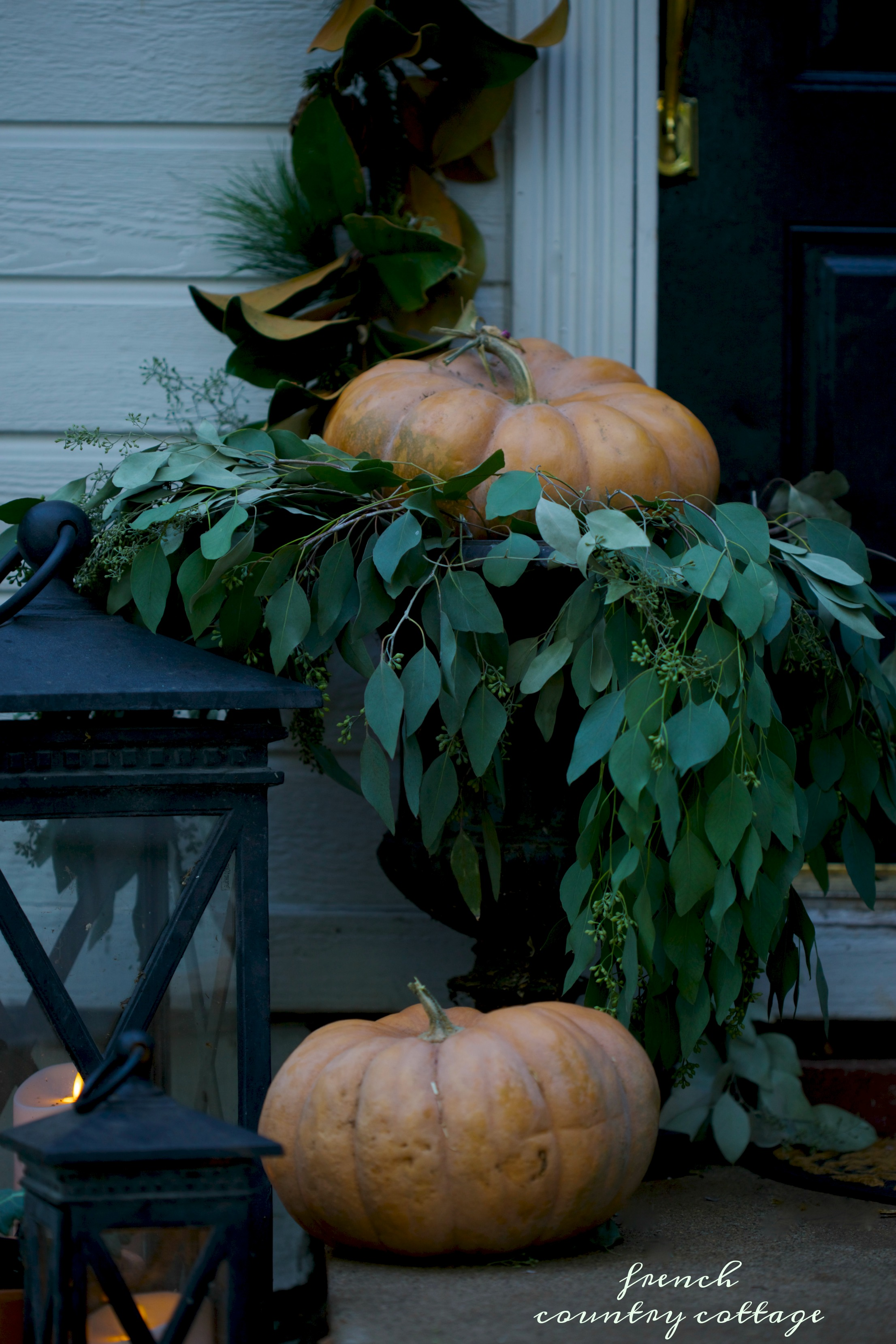 Porch with charming pumpkins and lanterns