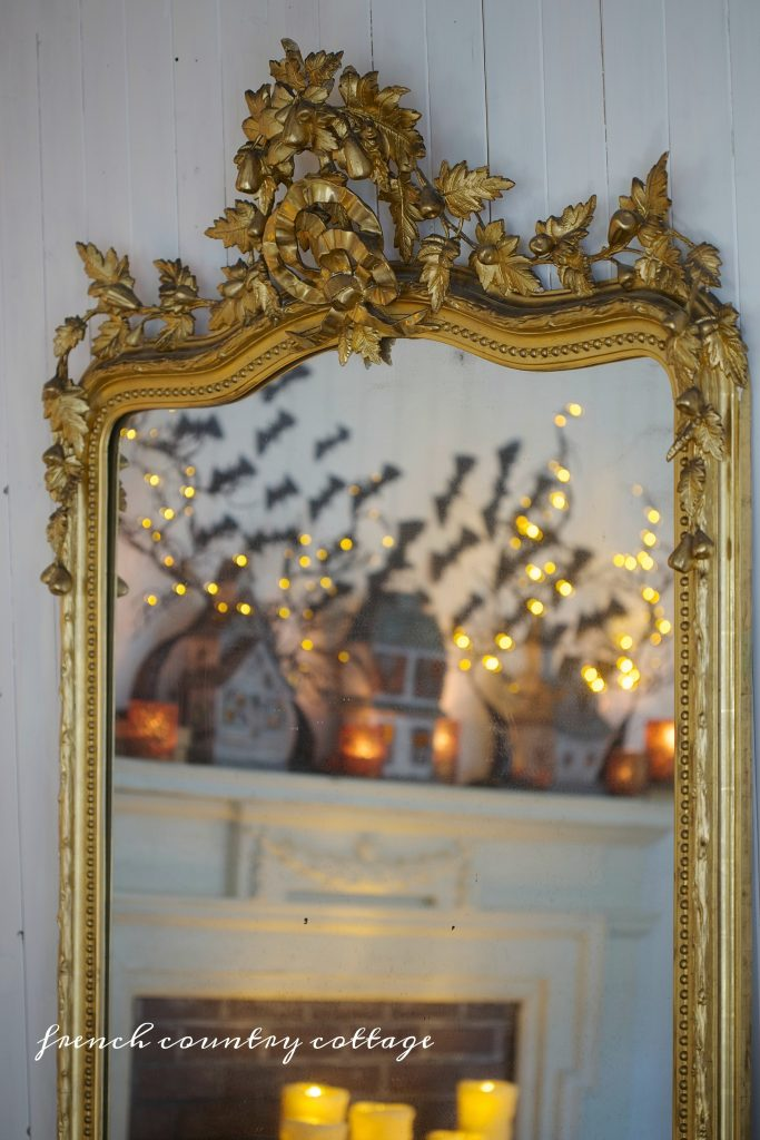 Style your mantel this Halloween with tabletop décor, candles, and LED lights