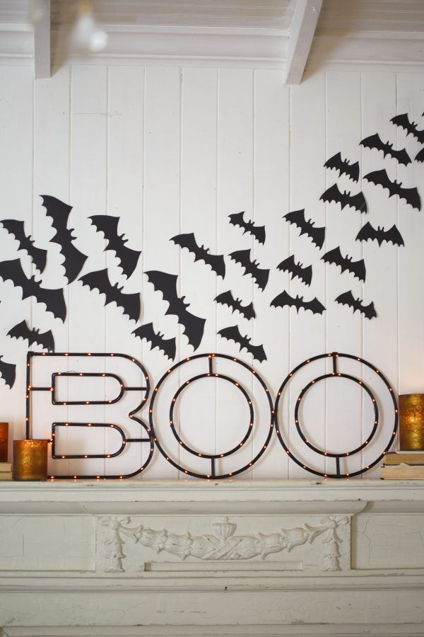 Balsam Hill's Halloween BOO Sign on top of mantel