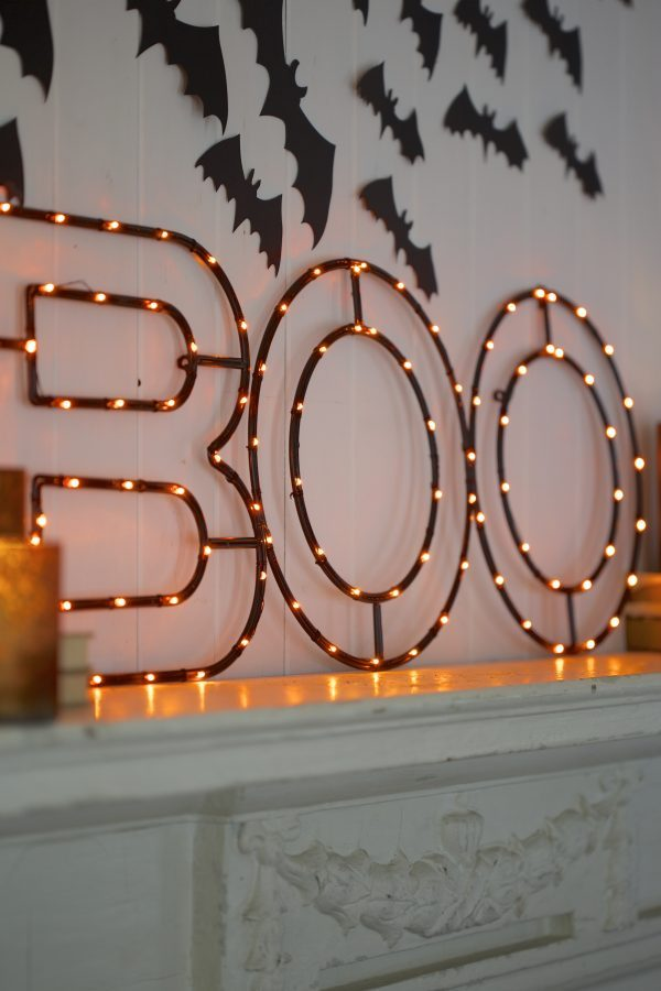 Balsam Hill's Halloween BOO Sign, lit on top of mantel
