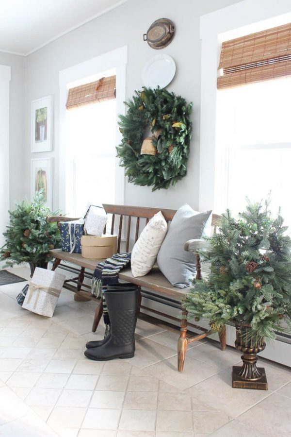 Our Evergreen Magnolia Wreath and Wintry Woodlands Foliage add rustic tones to this entryway