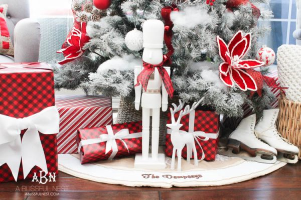 """This light-colored tree skirt stood out beautifully against the dark hardwood floor, and made the whole Christmas tree display """"float"""" (Photo courtesy of A Blissful Nest)"""