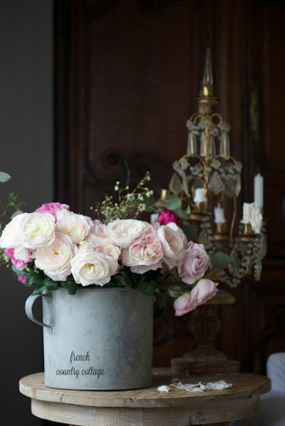Galvanized zinc bucket with roses and eucalyptus