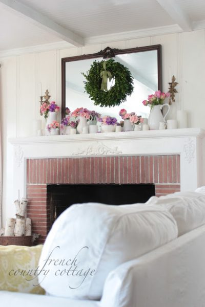 Gorgeous decorated mantel with flowers and wreath