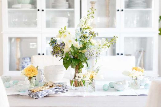 Balsam Hill's Blue Viola Arrangement styled in a white and pastel kitchen table setting