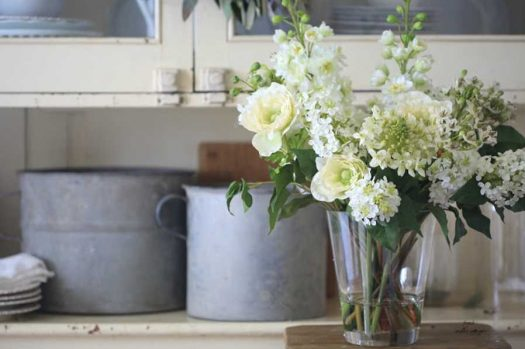 Our White Viola Flower Arrangement added a fresh accent to this rustic countertop