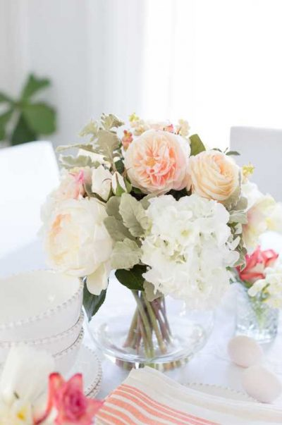 Our Jane Arrangement of anemones, hydrangeas and roses added pastel charm to this tablescape