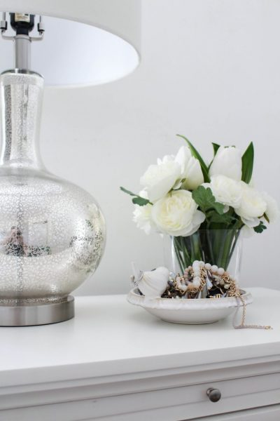 This floral arrangement displayed beautifully with metallic elements