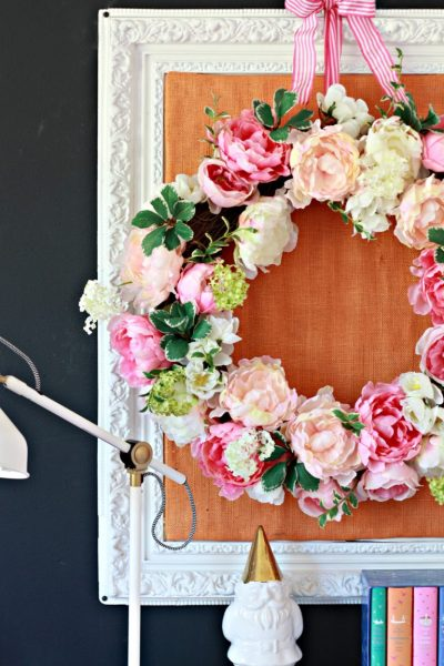 The soft shapes of this Peony Wreath displayed well against a burlap frame