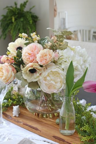 This mixed flower arrangement displayed beautifully along freshly-picked greenery