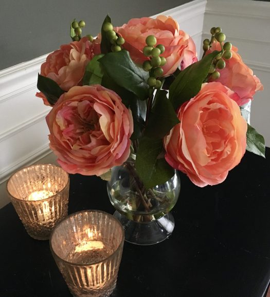 The peach tones of these pretty roses add feminine charm