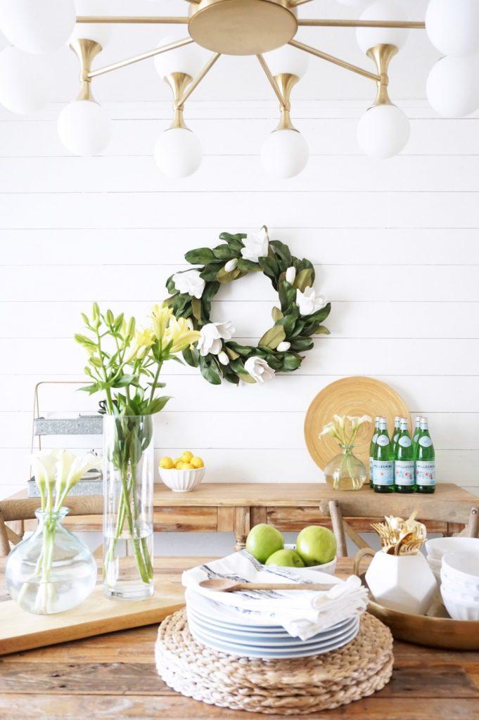 Balsam Hill Spring Magnolia wreath hung on sideboard buffet wall