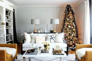 living room with decorated christmas tree in a corner
