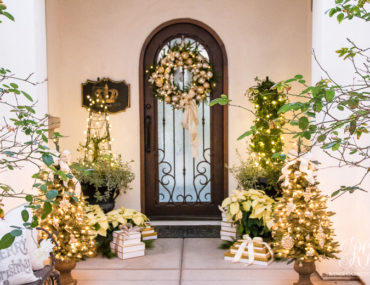 Porch decorated with artificial wreath and garlands