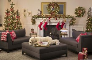living room decorated with pre-lit Christmas foliage