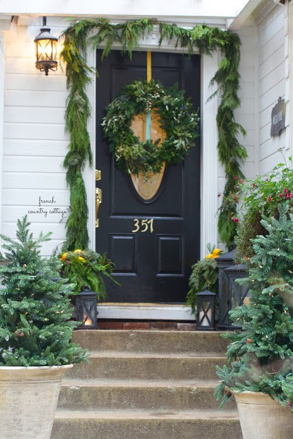 front steps decorated with natural elements photo courtesy of french country cottage