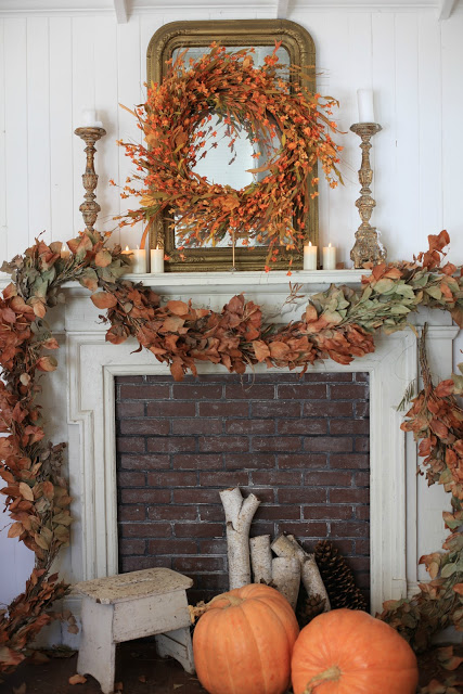 Our Sunset Meadow Wreath displayed atop a stunning fall mantel