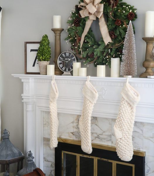 Red Spruce Woodland Charm Wreath, Chunky Knit Stocking in Ivory, Rustic Oak Faux Bois Candle Holders, Pushwick LED Flameless Pillar Candles