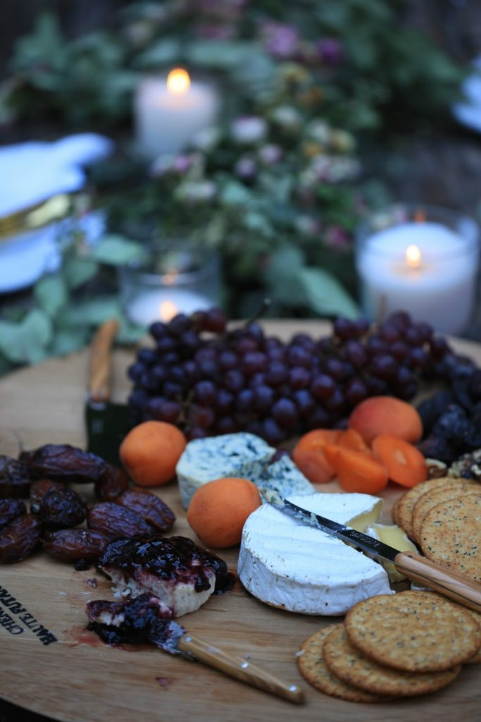 Nuts, dried fruits, and cheese on a serving platter