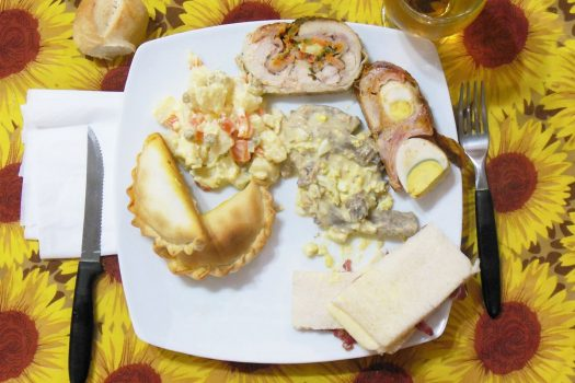 This Argentinian Christmas Eve meal consists of Ensalada Rusa (Russian salad), beef empanadas, Matambre (Argentinian style stuffed beef), and Pionono (sponge cake)