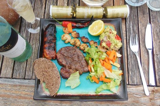 Enjoy a good Christmas barbecue with grilled meat, seafood, and fresh greens.