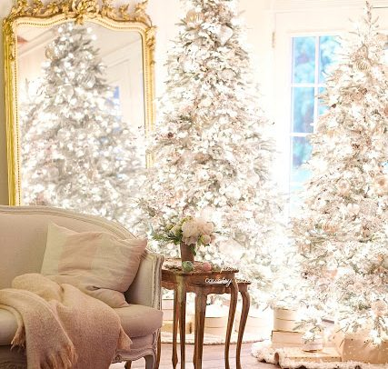 A Pair Of Frosted Trees Bring Wintry Beauty To This Living Room