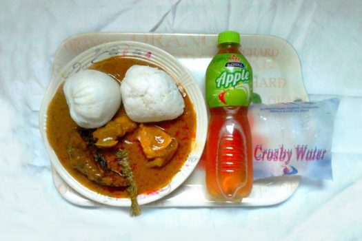A traditional Christmas plate of African groundnut stew, sticky rice, and fufu.