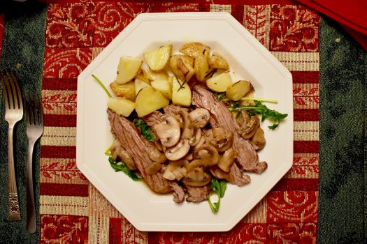 This Mexican Christmas dinner menu: ponche Navideño, Mexican-style grilled leg of lamb, and sides of mushrooms and potatoes