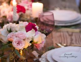 Courtney of French Country Cottage outdoor tablescape with flowers and candles