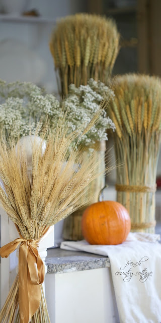 Autumn decor with wheat sheaves