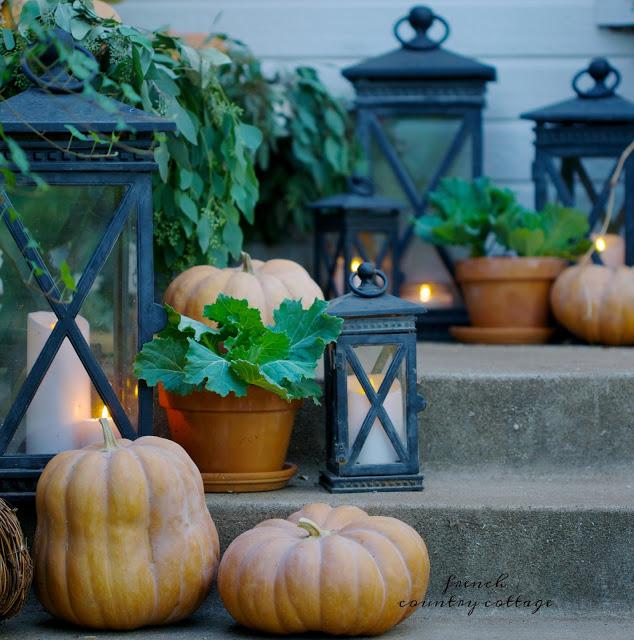 Autumn porch decor with pumpkins and lanterns
