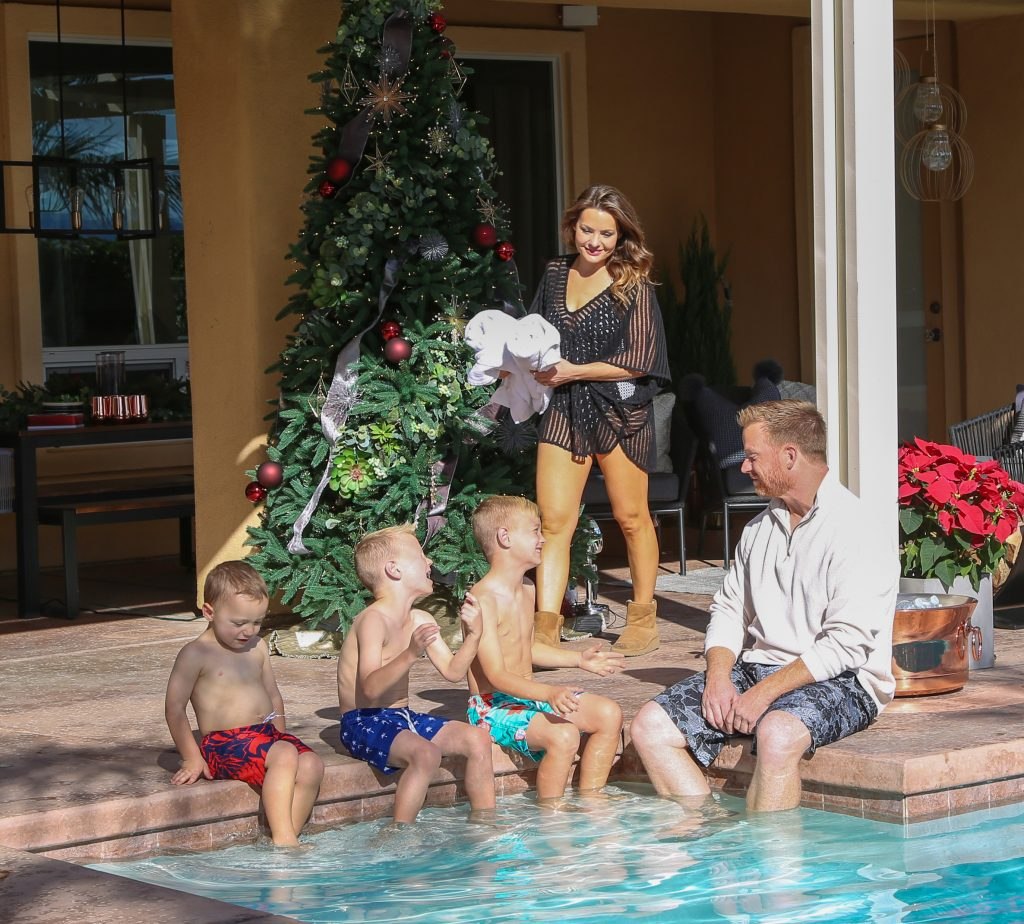 Eric and Lindsey of the Desert Flippers enjoy the pool with their three kids