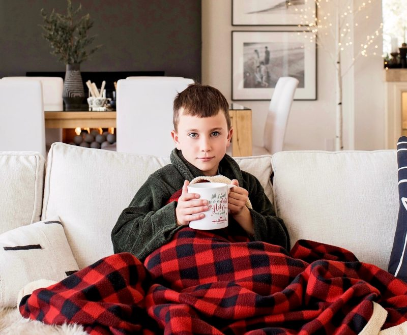 Aedriel serves hot cocoa during a movie night featuring Hallmark Channel original movies