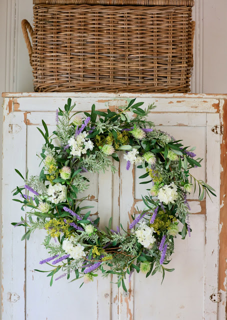 Courtney adorns the front of a closet with a French Market Floral Wreath