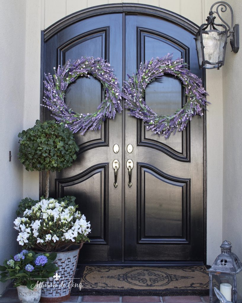 Sheila of Maison De Cinq displaying two Provencal Lavender Wreaths on her front door, one of the best places to hang wreaths