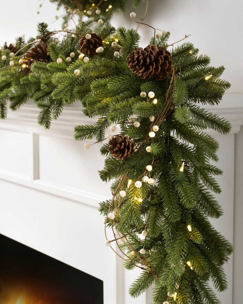 Balsam Hill Red Spruce Woodland Charm Garland on a mantel