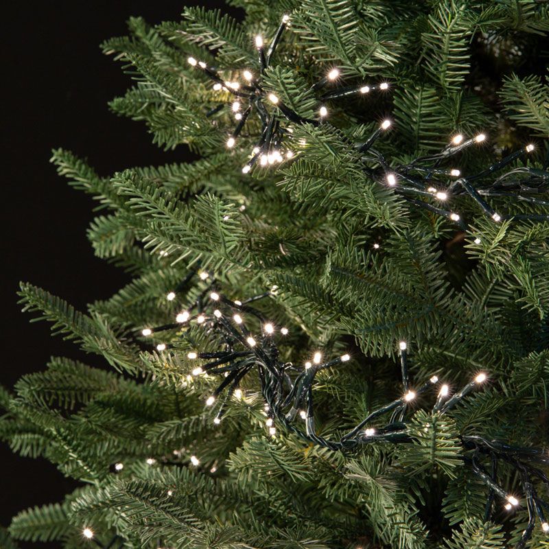 Micro LED light string strands on tree
