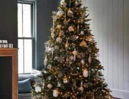 winter white ornaments on pre-lit Christmas tree