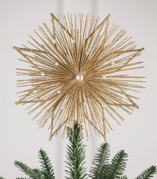 Designer tree topper on top of Christmas tree