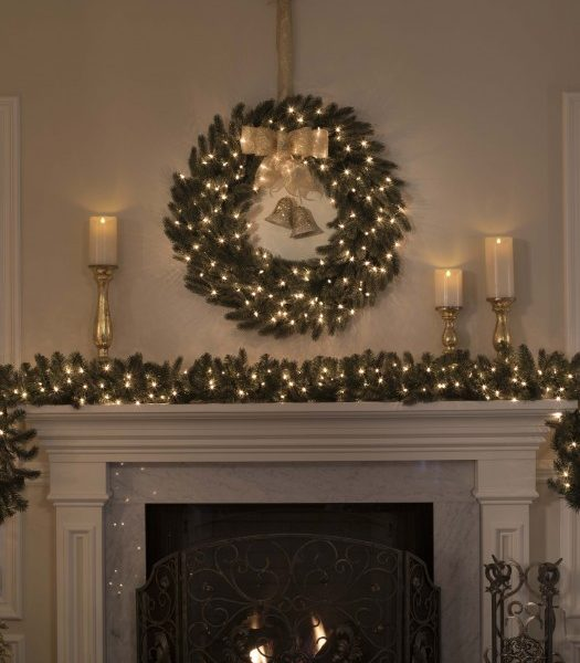 Balsam Hill Fraser Fir Wreath and Garland with candles on fireplace mantel