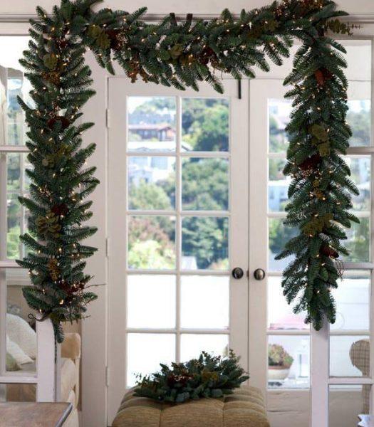 Balsam Hill Artificial Garland Greenery over double glass doors