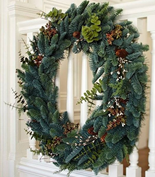 Balsam Hill Mountain Meadow Wreath on banister
